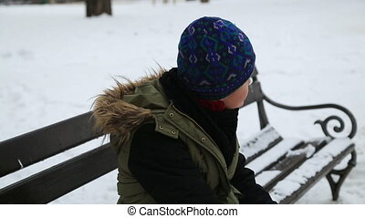 Winter portrait of sad kid boy at the outdoors