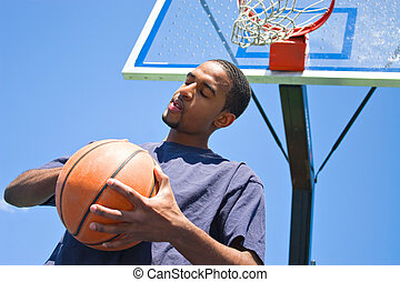 Basketball Player - African American man posing with a...