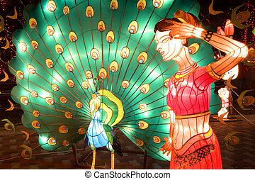 Lanterns - Image of lighted up lanterns depicting a peacock...