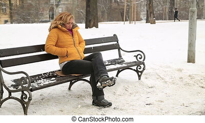 Winter portrait woman sneezing at the outdoors - Portrait of...