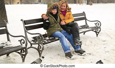 Woman and her son spend time in winter park