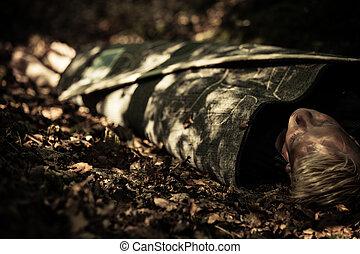 Dead body of a teenage boy lying in a forest - Dead body of...
