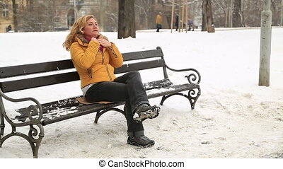 Woman freezing in the ice cold winter snow