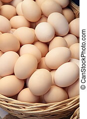 Organic eggs in basket close up image