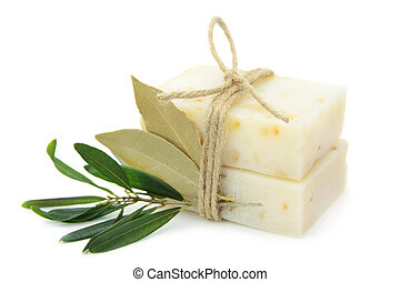 Natural herbal soaps with olive and bay leaf isolated on...