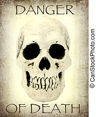 Human skull with the sample text danger of death close up...
