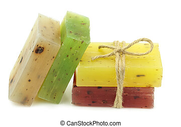 Colorful natural herbal soaps isolated on white background.