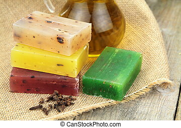 Colorful natural herbal soaps on linen sack close up image