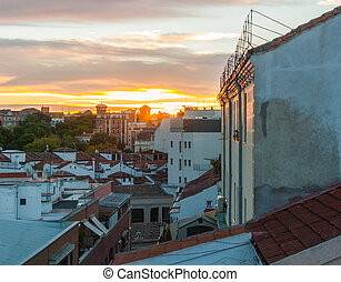 Dramatic color sunset rooftops of Madrid. Glowing fiery...