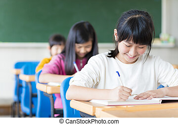 happy teenager girl learning in the classroom