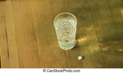 man washes down the pill with a glass of water - young man...