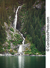 High waterfall in Alaskan fjords