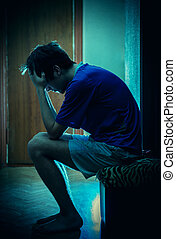 Sad Young Man - Toned Photo of Sad Young Man sit in the Dark...
