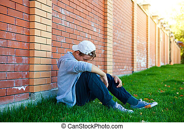 Sad Teenager outdoor - Sad Teenager sit by the Brick Wall...