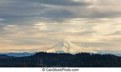 Time lapse of clouds and sky over snow covered mt Hood in...