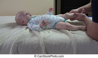 Father massage happy infant baby at home. 4K - Father...