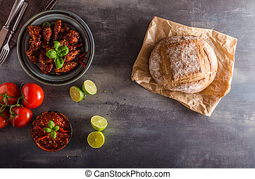 Chicken wings hot sauce, delicious, place for text, place...