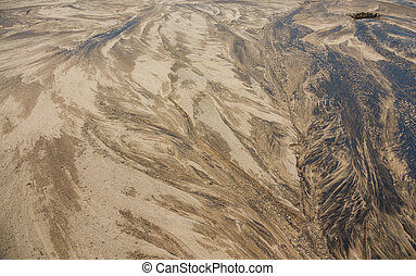Sand in riverbed, background texture - Closeup view of sand...