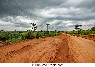Uganda road on a cloudy day - Wide angle view Uganda road on...