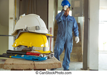 Yellow and White Helmet with Working Tool of Engineer...