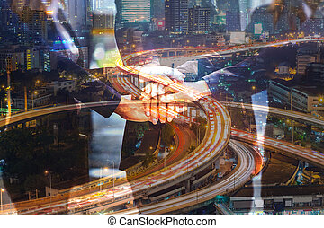 Double Exposure of Business People join hand as Teamwork United and Urban Expressway or Autobahn