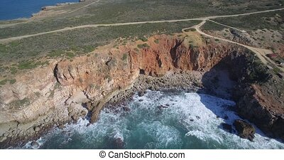 Aerial, Steep Cliff Lines At Praia Da Zimbreirinha, Portugal...