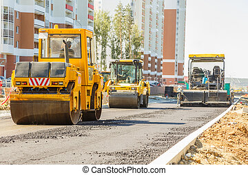 Road roller working at road construction site