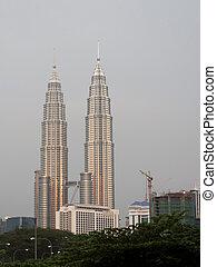 Petronas towers - Golden Petronas towers during sunset