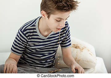 Young boy vomiting on his bed - Half body portrait of sick...