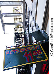Barber Shop Sign - Low angle view of a barber's offer for...