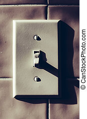 Light Switch - Off - Light switch on tile ceramics wall...