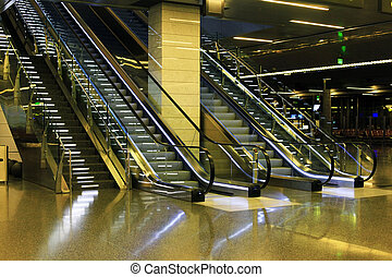 Doha International Airport - Escalator for passengers in the...