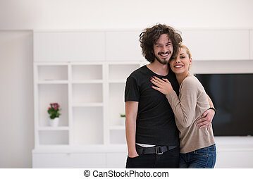 couple hugging in their new home - Portrait of a happy young...