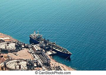 Ship at gas terminal - Ship unloading at liquefied natural...