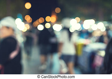 People walking at Festival Event Party and bokeh Blurred...