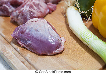 Cheek pieces of iberian pork with vegetables - Raw meat...