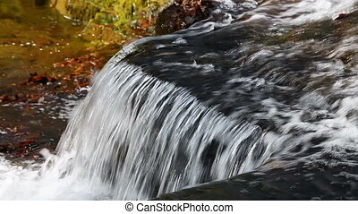 Clinton Falls Plunge Loop - Water splashes over Clinton...