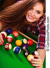 Young woman having fun with billiard. - Play jokes and fun...