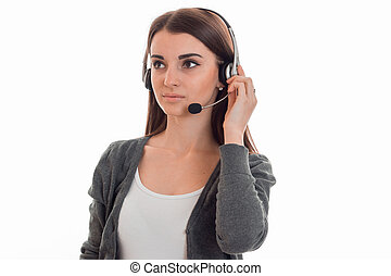 attractive young call center office girl with headphones and...