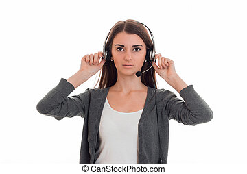 serious young call center office girl with headphones and...
