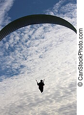 Man Hang Glides On Offshore Air Currents - Photo taken from...
