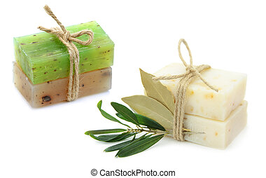 Natural herbal soaps with olive and daphne leaf close up...
