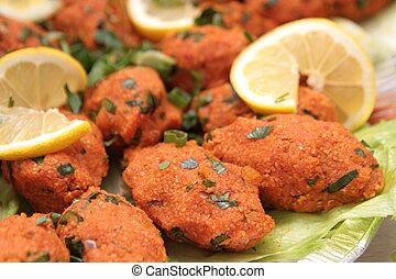 Turkish cuisine. Bulgur and lentil vegetarian dumplings (...