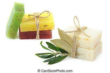 Natural herbal soaps with olive and daphne leaf on white...