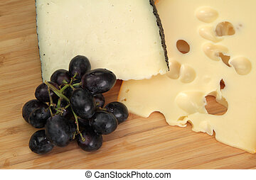 Cheese and grape close up image