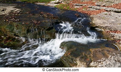Clinton Falls Splash Loop - Water splashes over Clinton...
