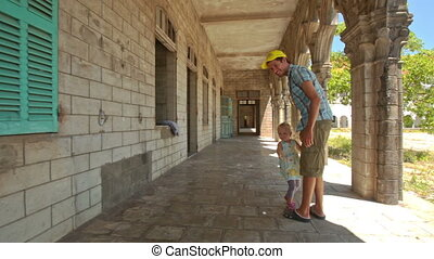 Father Little Girl Squat in Gallery Shade of Gothic Building...