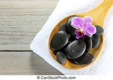 basalt stones for hot stone massage with accessories on...