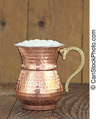 Ayran - Traditional Turkish yoghurt drink in a copper metal...