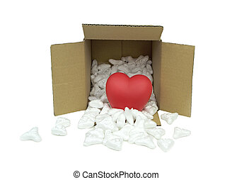 Red heart in mail package box with styrofoam on white...